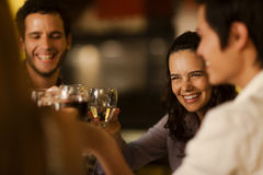 Group of friends toasting with wine. At a restaurant Stock Photo