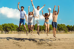 Group of friends together on the beach having fun. Royalty Free Stock Images