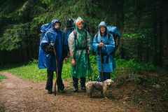 Group of friends traveling together in bad rainy weather Stock Photography