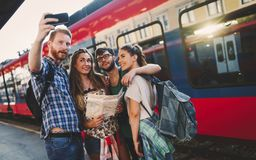 Group of friends traveling by train. Group of happy tourists traveling by train royalty free stock image
