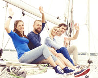 Group of happy friends traveling on a yacht, enjoying a good sum. Group of friends traveling on a yacht, enjoying a good summer day. Holiday, vacation and royalty free stock image