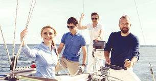 Group of happy friends traveling on a yacht. Tourism, vacation,. Group of friends traveling on a yacht and enjoying a good summer day. Vacation, holiday stock photo