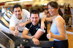 Group of friends on treadmill with thumbs up Stock Photography