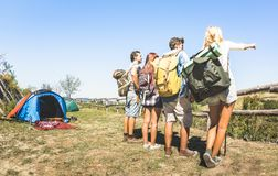 Group of friends trekking at trip camp on italian hills on sunny royalty free stock photography