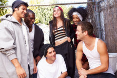 Group Of Friends In Urban Setting Standing By Fence Royalty Free Stock Photography