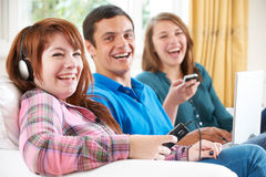 Group Of Friends Using Digital Technology At Home Royalty Free Stock Photo