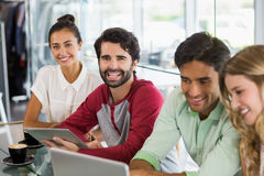 Group of friends using laptop while having cup of coffee Stock Photography