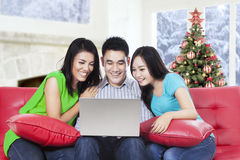 Group of friends using laptop on the sofa Royalty Free Stock Image