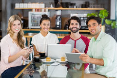 Group of friends using mobile phone, digital tablet and laptop Stock Image