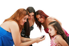 Group of friends using a mobile Royalty Free Stock Images