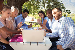 Group of friends video chatting on laptop Royalty Free Stock Photography