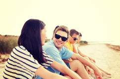 Group of friends or volleyball team on the beach Royalty Free Stock Image