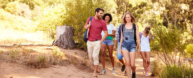 Group Of Friends On Walk Through Countryside Together Stock Photos