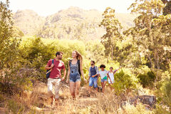 Group Of Friends On Walk Through Countryside Together Stock Images