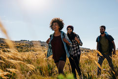 Group of friends on walk through countryside Stock Image