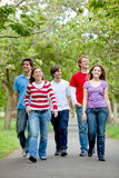 Group of friends walking Stock Photography