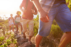 Group Of Friends Walking Along Coastal Path Together royalty free stock photography