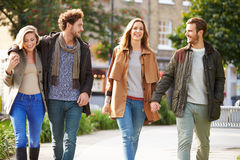 Group Of Friends Walking Through City Park Together Stock Photography