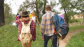 Group friends walking in a forest, looking for a place to stay stock footage