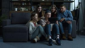 Group of friends watching media content on tablet