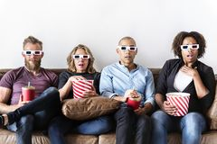 Group of friends watching a movie together stock photos