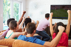 Group Of Friends Watching Soccer Celebrating Goal Stock Photo