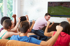Group Of Friends Watching Soccer Celebrating Goal Stock Image