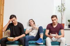 Group of friends watching together a ball game Royalty Free Stock Image
