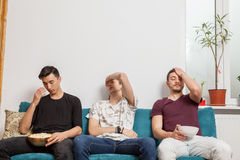 Group of friends watching together a ball game Royalty Free Stock Images
