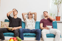 Group of friends watching together a ball game Stock Photo