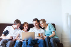 Group of friends watching tv Stock Image