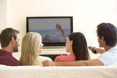 Group Of Friends Watching Widescreen TV At Home stock images