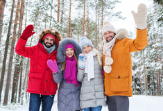 Group of friends waving hands in winter forest Stock Photography