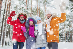 Group of friends waving hands in winter forest Royalty Free Stock Photos