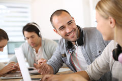 Group of friends websurfing in lounge Stock Image
