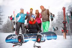 Group of friends on winter holidays - Skiers having fun on the s. Group of friends on winter holidays – smiling skiers having fun on the snow Royalty Free Stock Image