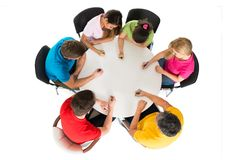 Group of friends writing on desk Royalty Free Stock Images