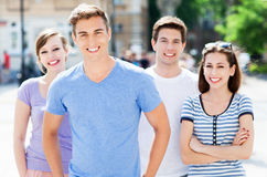 Group of friends. Young friends embracing and smiling Stock Photography
