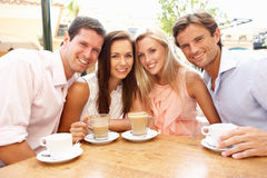 Group Of FriendsEnjoying Coffee Royalty Free Stock Photography