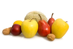 Group Of Fruits. Food & Drinks - Fruits. Group of fruits isolated on white background: nuts, plum, lemon, golden apples, pears and melon Royalty Free Stock Photo