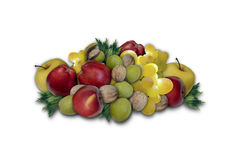 Group of fruits and nuts harvested in autumn. Autumn apples and grapes in a group with walnuts and hazelnuts on a white background Stock Photo
