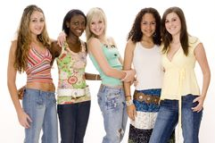 Group Fun. A group of five attractive young women in casual outfits on white background royalty free stock images