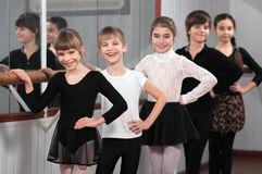 Group of children standing at ballet barre