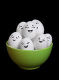 A group of funny and happy egg smiley collection in bowl with bl Royalty Free Stock Photography
