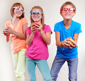 Group of funny kids with apples posing Stock Photo