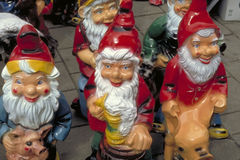 A group of garden gnomes. A group of jolly garden gnomes dressed in bright red royalty free stock photography