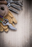 Group of gardening tools on wooden board top view agriculture co Royalty Free Stock Photo
