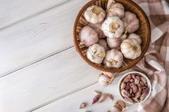 Group of garlic on white wooden table board , top view or overh Stock Photography