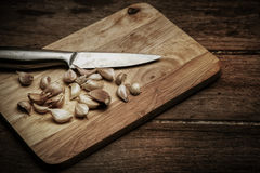 Group of garlics  with knife Royalty Free Stock Photos