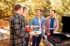 Group Of Gay Male Friends Enjoying Barbeque Together Stock Photography